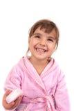 Tvättande hand och framsida för liten flicka Royaltyfri Foto