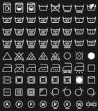 Tvätterisymboler och tvagningsymboler Fotografering för Bildbyråer