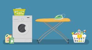 Tvättstuga med en tvagningmaskin och en gulingstrykbräda Arkivbild
