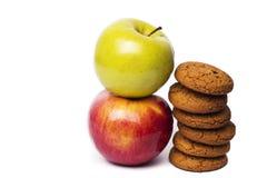 Två äpplen som är röda - läckert och grönt royaltyfri fotografi