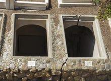Två öppna gravvalv i en kyrkogård Royaltyfria Foton