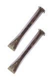 två använda stålstämjärn som isoleras på vit Royaltyfri Bild
