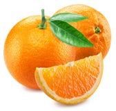 Två apelsiner och segment av frukt Royaltyfri Fotografi