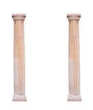 Två arkitektoniska kolonner på en vit bakgrund Arkivfoton