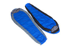 Två av sovsäckarna i en kompression hänger löst royaltyfri foto