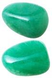 Två Aventurine gemstones som isoleras på vit Fotografering för Bildbyråer