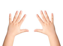 Två barnhänder på en isolerad bakgrund Arkivfoto