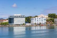 Två blåa byggnader på St Lucia Harbor Arkivfoto