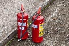 Två brandsläckare som är klara för bruk royaltyfria bilder