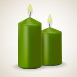 Två brinnande gröna isolerade vektorstearinljus Arkivbild