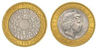 Två brittiska pund mynt Fotografering för Bildbyråer