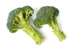 Två broccoli på vit royaltyfri fotografi