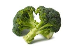 Två broccolies på vit royaltyfri foto