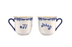 Två dekorativa koppar som isoleras på vit Arkivfoto