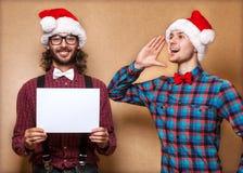 Två emotionella Santa Claus Arkivfoto
