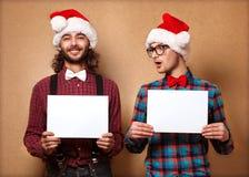 Två emotionella Santa Claus Fotografering för Bildbyråer