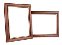 Två enkla trä föreställer inramar med skuggar Fotografering för Bildbyråer