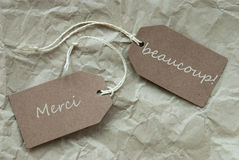Två etiketter Merci Beau Means Thank Paper Background Arkivbilder