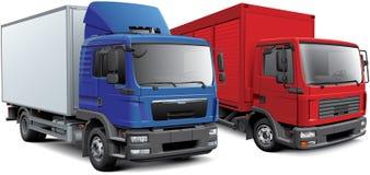 Två europeiska asklastbilar Arkivfoton