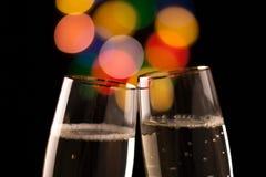 Två exponeringsglas av champagne Arkivfoton