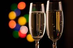 Två exponeringsglas av champagne Arkivbild