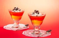 Två exponeringsglas av gelé med den piskade krämen royaltyfri fotografi
