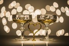 Två exponeringsglas en hjärta Arkivfoton