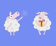 Två får med gåvor och snöflingor Fotografering för Bildbyråer
