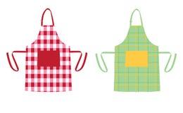 Två förkläden med kökmodeller stock illustrationer