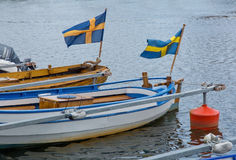 Två fartyg med svenska flaggor Fotografering för Bildbyråer