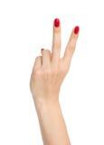 Två fingrar upp i fred- eller segersymbolet som tecknet för V lät royaltyfria foton