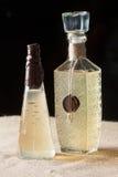Två flaskor av ljus - gul flytande som förseglas med vaxet Arkivbilder