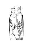 Två flaskor av olivolja på vit bakgrund Arkivbilder