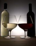 Två flaskor och exponeringsglas Royaltyfria Foton