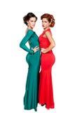Två flickor i härliga klänningar Royaltyfria Bilder