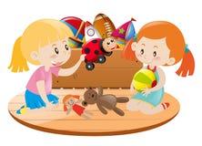 Två flickor som spelar med leksaker i rum stock illustrationer