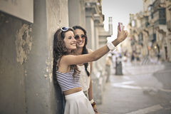 Två flickor tillsammans Fotografering för Bildbyråer