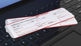 Två flygbiljetter på den svarta bärbara datorn Royaltyfria Bilder