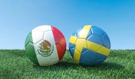 Två fotbollbollar i flaggafärger arkivfoto