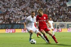 Två fotbollspelare i duell Fotografering för Bildbyråer