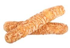 Två frasiga breadsticks med bearbetad ost som isoleras på en vit bakgrund Läcker och bakad ostbagett arkivfoton