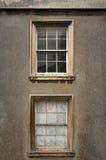 Två gamla fönsterramfönster Arkivbilder