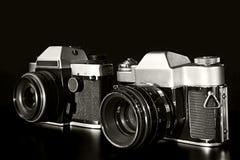 Två gamla filmkameror Arkivfoto