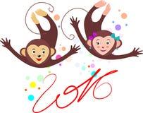 Två gladlynta apor med ett skämtsamt lynne och med inscriptioen Royaltyfri Bild