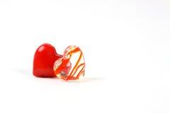 Två glass glansiga hjärtor Fotografering för Bildbyråer