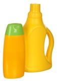 Två gula plastic flaskor Royaltyfria Bilder