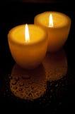 Två gula stearinljus Fotografering för Bildbyråer