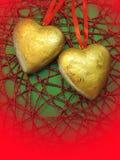 Två guld- hjärtor Fotografering för Bildbyråer