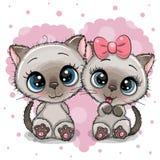 Två gulliga kattungar på en hjärtabakgrund royaltyfri illustrationer