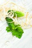 Två gurkor och parsley på wood shavings Royaltyfria Bilder